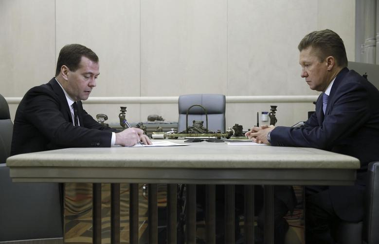 Russia's Prime Minister Dmitry Medvedev (L) meets with Gazprom Chief Executive Alexei Miller in Moscow, April 3, 2014. REUTERS/Dmitry Astakhov/RIA Novosti/Pool