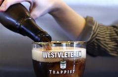 An employee pours a Westvleteren Trappist beer at the brewery in Westvleteren February 18, 2014. REUTERS/Francois Lenoir