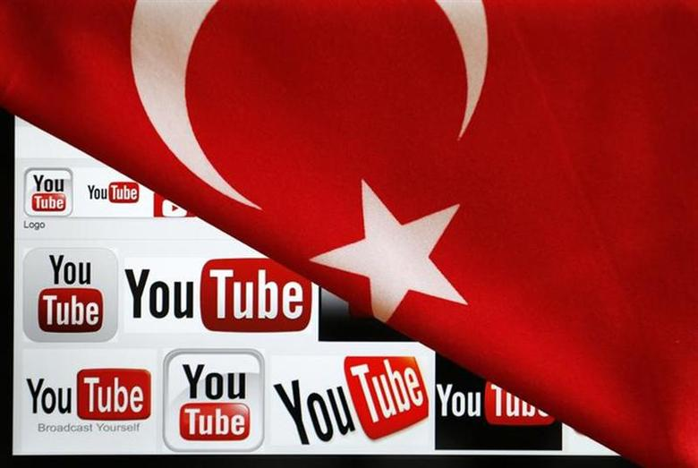YouTube logos displayed on a laptop screen partially covered with Turkey's national flag in this photo illustration taken in Ankara March 27, 2014. REUTERS/Umit Bektas/Files