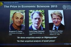 Photos of the 2013 Nobel Prize laureates in Economic Sciences Eugene Fama (L-R), Lars Peter Hansen and Robert Shiller are displayed during a news conference at the Royal Swedish Academy of Sciences in Stockholm October 14, 2013. REUTERS/Claudio Bresciani/TT News Agency