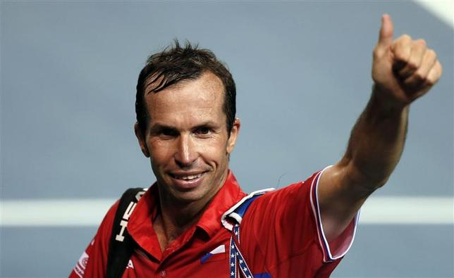 Radek Stepanek of the Czech Republic gestures to the crowd as he leaves the court after winning his Davis Cup quarter-final tennis match against Japan's Tatsuma Ito in Tokyo April 4, 2014. REUTERS/Yuya Shino