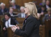 Canada's Transport Minister Lisa Raitt speaks during Question Period in the House of Commons on Parliament Hill in Ottawa March 26, 2014. REUTERS/Chris Wattie