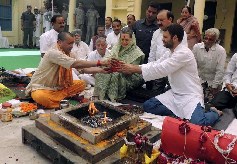 Chief of India's ruling Congress party Sonia Gandhi (C) and her son and Vice President of Congress Rahul Gandhi (front R) perform a religious ritual before Sonia filed her nomination for the upcoming general election at Rae Bareli in the northern Indian state of Uttar Pradesh April 2, 2014. REUTERS/Stringer