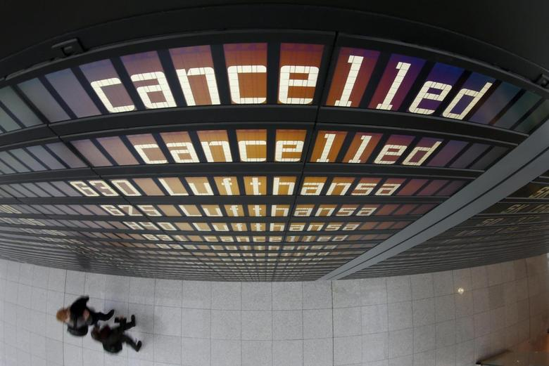 Cancelled flights of German airline Lufthansa are displayed on a flight schedule board at Munich's airport April 2, 2014. REUTERS/Michaela Rehle