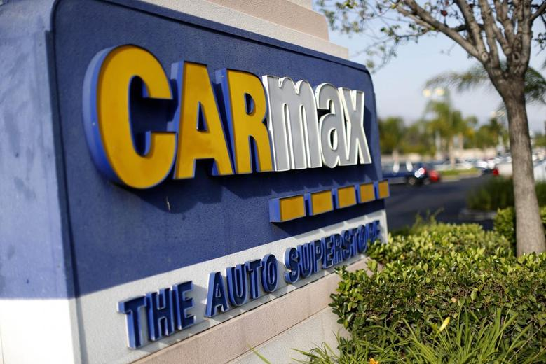 The sign of a CarMax dealership is pictured in Duarte, California March 28, 2014. REUTERS/Mario Anzuoni