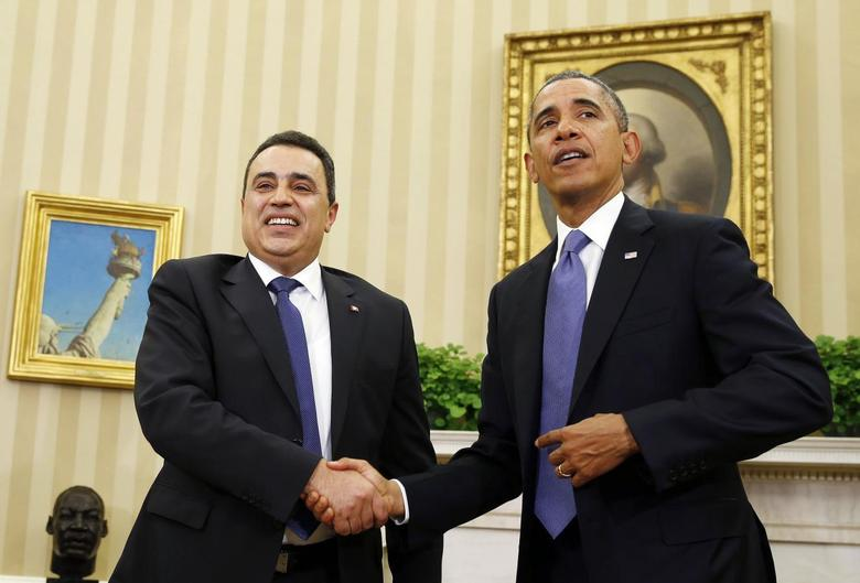 U.S. President Barack Obama and Tunisia's Prime Minister Mehdi Jomaa shake hands in the Oval Office of the White House in Washington, April 4, 2014. REUTERS/Larry Downing