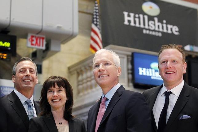 Hillshire Brands CEO Sean Connolly (2nd-R) poses with company executives on the floor of the New York Stock Exchange, July 3, 2012. REUTERS/Brendan McDermid