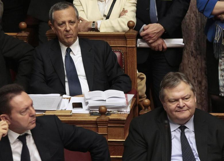 Government Secretary General Takis Baltakos (top) attends a parliamentary session with Greece's Finance Minister Yannis Stournaras (L) and Foreign Minister Evangelos Venizelos in Athens, March 30, 2014. REUTERS/Alkis Konstantinidis