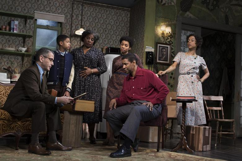 A scene from the play ''A Raisin in the Sun'' by Lorraine Hansberry is pictured in this undated handout photo courtesy of Brigitte Lacombe. From left, the cast are: David Cromer, Bryce Clyde Jenkins, LaTanya Richardson Jackson, Anika Noni Rose, Denzel Washington, and Sophie Okonedo. REUTERS/Brigitte Lacombe/Handout via Reuters