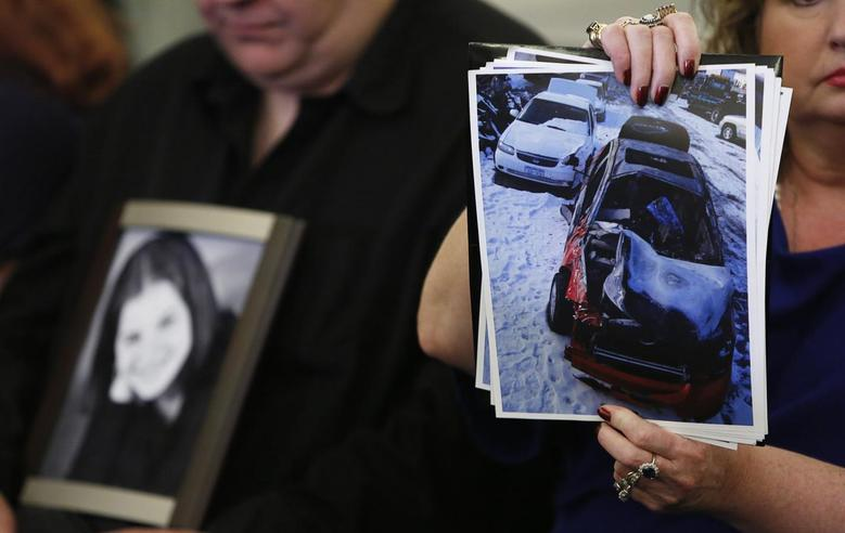 Surviving family member Leo Ruddy (L) holds a photo of his deceased daughter Kelly as his wife Mary Theresa holds up photos of Kelly's wrecked 2005 Chevrolet Cobalt, before the start of the Senate Commerce and Transportation Consumer Protection, Product Safety and Insurance subcommittee in Washington April 2, 2014. REUTERS/Gary Cameron