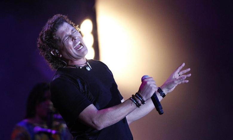 Colombian singer and composer Carlos Vives performs during the 55th International Song Festival in Vina del Mar city, about 121km (75 miles) northwest of Santiago, February 27, 2014. REUTERS/Eliseo Fernandez