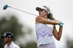Apr 4, 2014; Rancho Mirage, CA, USA; Lexi Thompson tees off on the seventh hole in the second round of the Kraft Nabisco Championship golf tournament at Mission Hills Country Club. Kelvin Kuo-USA TODAY Sports