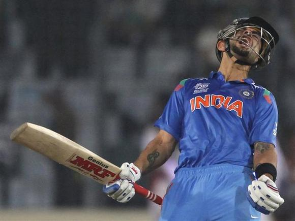 Virat Kohli celebrates after India won the semi final match against South Africa in the ICC Twenty20 World Cup at the Sher-E-Bangla National Cricket Stadium in Dhaka April 4, 2014. REUTERS/Andrew Biraj