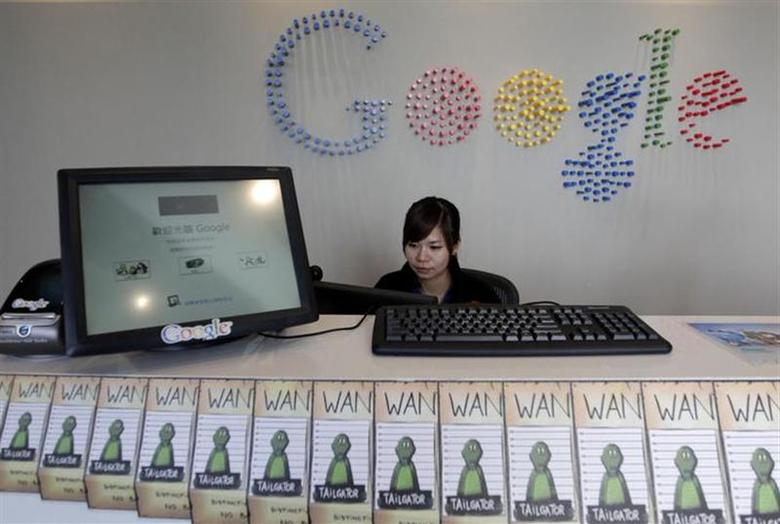 An employee sits behind a reception desk during a media tour in the Google data centre in Changhua Coastal Industrial Park, central Taiwan, December 11, 2013. REUTERS/Pichi Chuang/Files