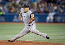 Apr 4, 2014; Toronto, Ontario, CAN; New York Yankees starting pitcher Masahiro Tanaka (19) throws a pitch during the fourth inning in a game against the Toronto Blue Jays at Rogers Centre. Mandatory Credit: Nick Turchiaro-USA TODAY Sports
