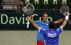 Lukas Rosol (facing camera) and Radek Stepanek of the Czech Republic celebrate after winning their Davis Cup men's doubles quarter-final tennis match against Japan's Tatsuma Ito and Yasutaka Uchiyama in Tokyo April 5, 2014. This win ensures the Czech team advances to the Davis Cup semi-finals. REUTERS/Yuya Shino