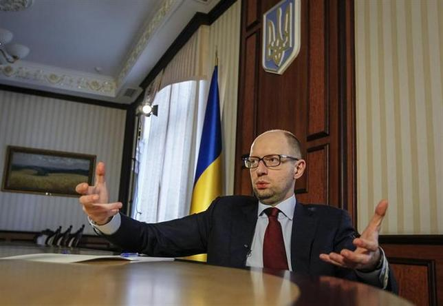 Ukrainian Prime Minister Arseny Yatseniuk gestures during an interview with Reuters in Kiev April 3, 2014. REUTERS/Valentyn Ogirenko