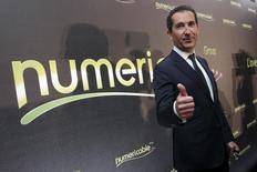 Vivendi aceptó la oferta de la empresa de televisión por cable Numericable por su unidad de telecomunicaciones SFR, lo que le dejaría a la compañía francesa al menos 13.500 millones de euros (18.500 millones de dólares) en efectivo, más una participación de un 20 por ciento en la nueva entidad. París, 17 de marzo de 2014 REUTERS/Philippe Wojazer