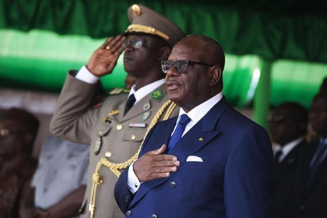 Malian President Ibrahim Boubacar Keita sings the national anthem during a military parade to mark Armed Forces Day in Bamako January 20, 2014 file photo. REUTERS/Joe Penney