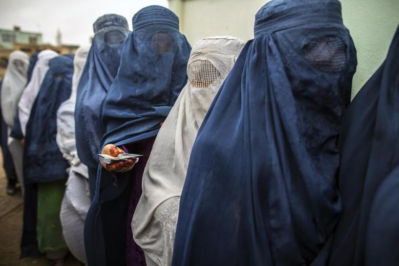 Afghan women stand in line while waiting for their turn to vote at a polling station in Mazar-i-sharif April 5, 2014. REUTERS/Zohra Bensemra