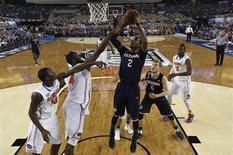 Apr 5, 2014; Arlington, TX, USA; Connecticut Huskies forward DeAndre Daniels (2) shoots the ball against Florida Gators center Patric Young (4) during the second half during the semifinals of the Final Four in the 2014 NCAA Mens Division I Championship tournament at AT&T Stadium. Mandatory Credit: Chris Steppig, NCAA Photos/Pool via USA TODAY Sports
