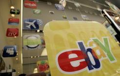 A placard advertising an eBay app for Apple is shown in San Francisco, California, April 22, 2009. REUTERS/Robert Galbraith