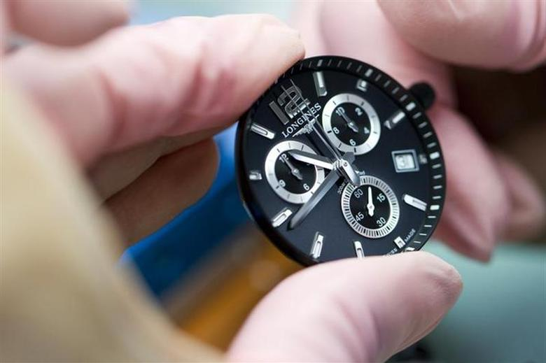 A wrist watch of Swiss watch maker Longines is assembled at the company headquarters in Saint-Imier September 27, 2012. REUTERS/Valentin Flauraud