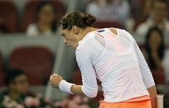 Andrea Petkovic of Germany reacts after scoring a point against Victoria Azarenka of Belarus at the China Open tennis tournament in Beijing September 30, 2013. REUTERS/Kim Kyung-Hoon