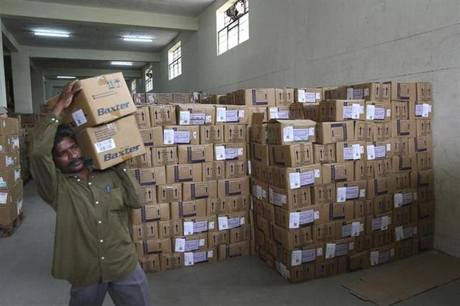 A worker carries a box containing medicine inside a district drugs warehouse of Tamil Nadu Medical Services Corporation Limited in Chennai July 12, 2012. REUTERS/Babu/Files