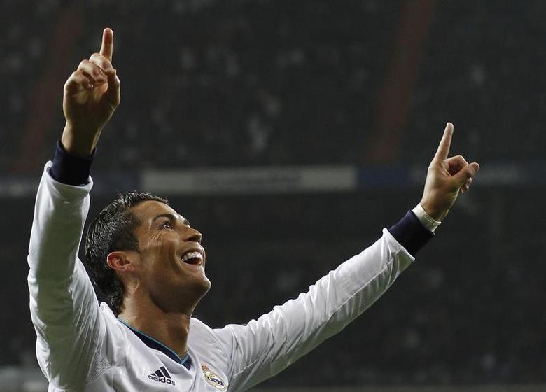 Real Madrid's Cristiano Ronaldo celebrates his second goal during their Spanish King's Cup soccer match against Celta Vigo at Santiago Bernabeu stadium in Madrid January 9, 2013. REUTERS/Juan Medina