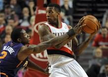 Apr 4, 2014; Portland, OR, USA; Phoenix Suns guard Eric Bledsoe (2) reaches in on Portland Trail Blazers forward Thomas Robinson (41) during the first quarter of the game at Moda Center. Mandatory Credit: Steve Dykes-USA TODAY Sports