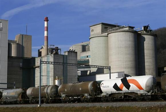 A Holcim logo is pictured on a wagon at the cement works in Eclepens near Lausanne February 25, 2014. REUTERS/Denis Balibouse