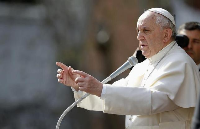 Pope Francis gestures as he talks to the faithful during a visit to parish San Gregorio Magno in Rome April 6, 2014. REUTERS/Tony Gentile