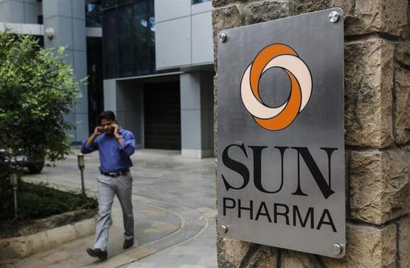 An employee speaks on phone as he walks out of research and development centre of Sun Pharmaceutical Industries Ltd in Mumbai April 7, 2014. REUTERS/Danish Siddiqui