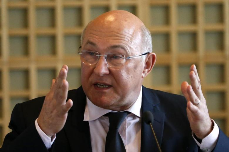 Michel Sapin, France's newly-named Finance Minister and outgoing Labour, Employment and Social Dialogue Minister, delivers a speech during the official handover ceremony at the Bercy Finance Ministry in Paris April 3, 2014. REUTERS/Charles Platiau