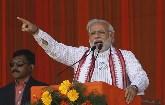 Hindu nationalist Narendra Modi, prime ministerial candidate for the main opposition Bharatiya Janata Party (BJP) and Gujarat's chief minister, addresses his supporters during a rally in Amroha, in Uttar Pradesh March 29, 2014. REUTERS/Adnan Abidi