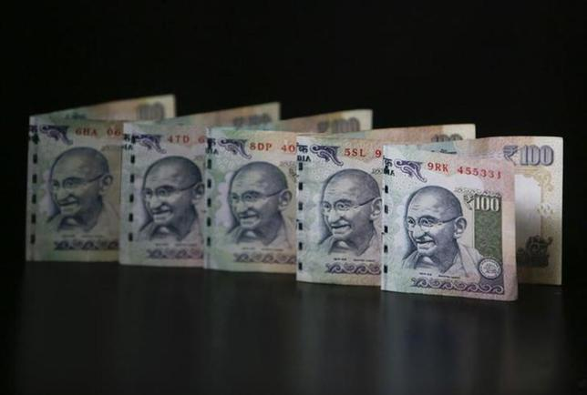 Rupee notes are seen in this picture illustration taken in Mumbai June 12, 2013. REUTERS/Vivek Prakash/Files