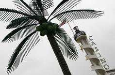 A casino sign stands behind a plastic palm tree in Blackpool, northern England, January 30, 2007. REUTERS/Phil Noble