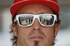 Ferrari Formula One driver Fernando Alonso of Spain arrives at the paddock ahead of the Malaysian F1 Grand Prix at Sepang International Circuit outside Kuala Lumpur March 25, 2012. REUTERS/Edgar Su