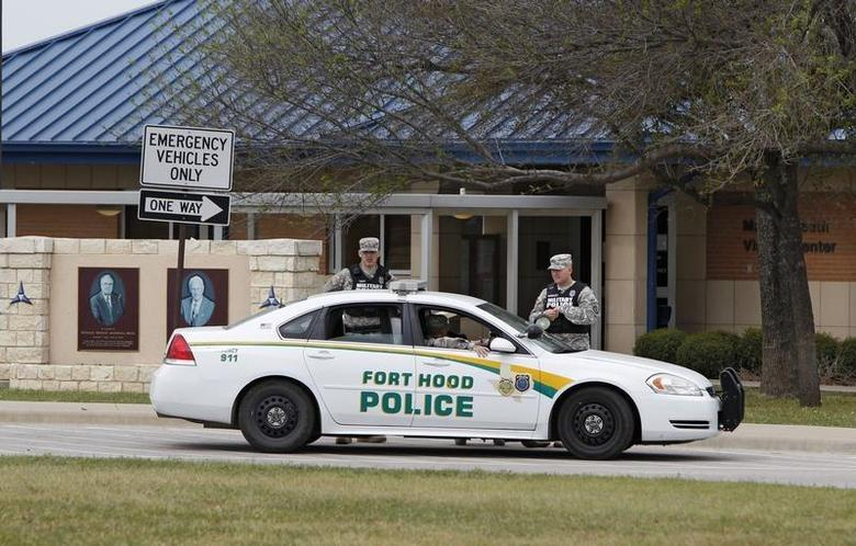Fort Hood military police guard the visitor's center, after Wednesday's shooting, at the entrance to Fort Hood, Texas April 3, 2014. REUTERS/Erich Schlegel