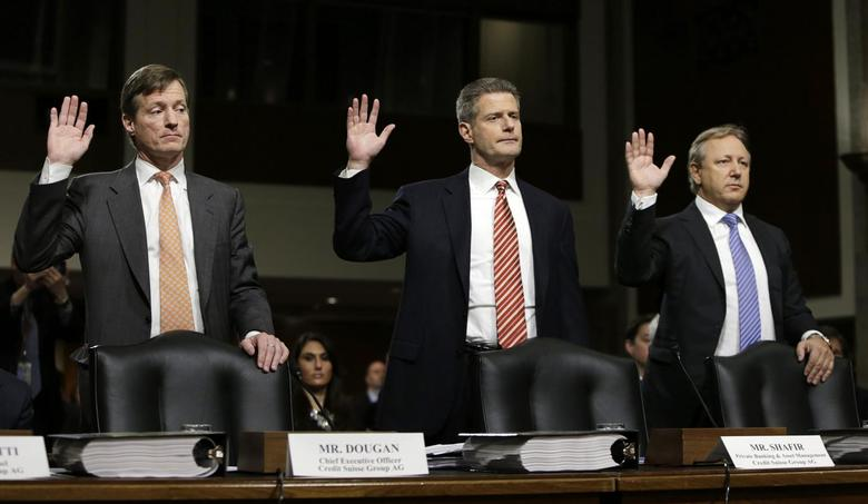(L-R) Credit Suisse officials CEO Brady Dougan, Robert Shafir and Hans Urlich-Mesiter are sworn in before the Senate Homeland and Governmental Affairs Investigations Subcommittee on Capitol Hill in Washington February 26, 2014. REUTERS/Gary Cameron