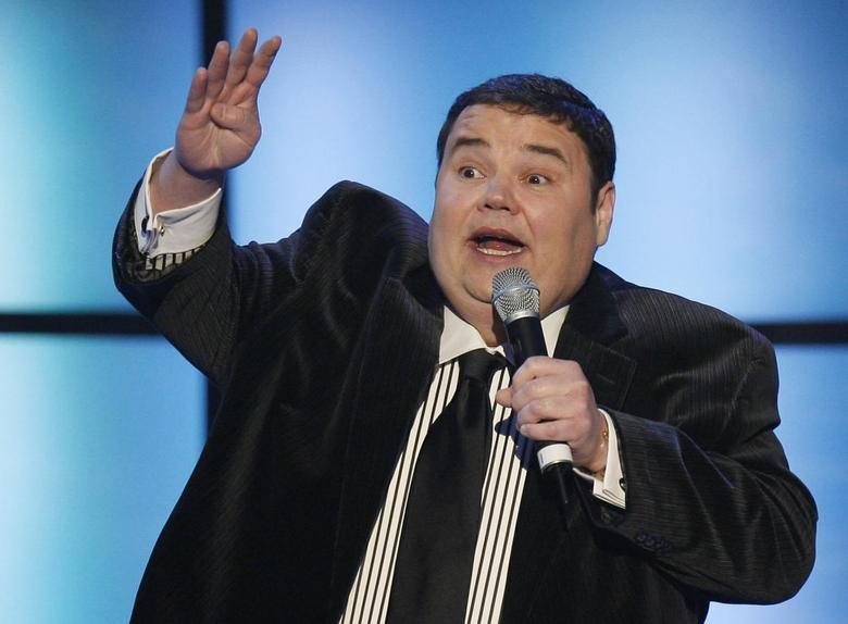 Comedian John Pinette addresses the crowd during the 2008 NASCAR Sprint Cup Series Awards Ceremony in New York in this December 5, 2008 file photo. REUTERS/Lucas Jackson/Files