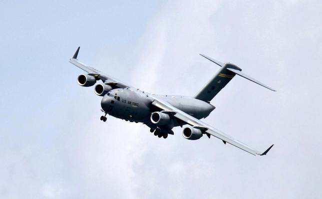 A Boeing C-17 Globemaster III military transport aircraft of the United States Air Force (USAF) performs a fly-by during the Singapore Airshow in Singapore in this February 15, 2012, file photo. REUTERS/Tim Chong/Files