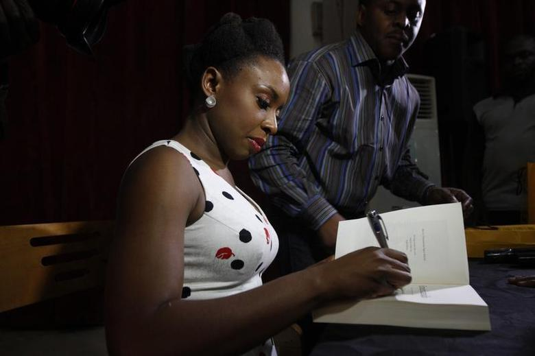 Nigerian novelist Chimamanda Ngozi Adichie signs an autograph after a reading of her new book 'Americanah' in Lagos April 27, 2013. REUTERS/Akintunde Akinleye