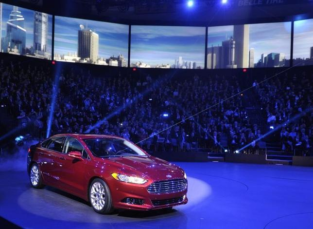 The 2013 Ford Fusion is unveiled on the first press preview day for the North American International Auto Show in Detroit, Michigan, January 9, 2012. REUTERS/Mike Cassese