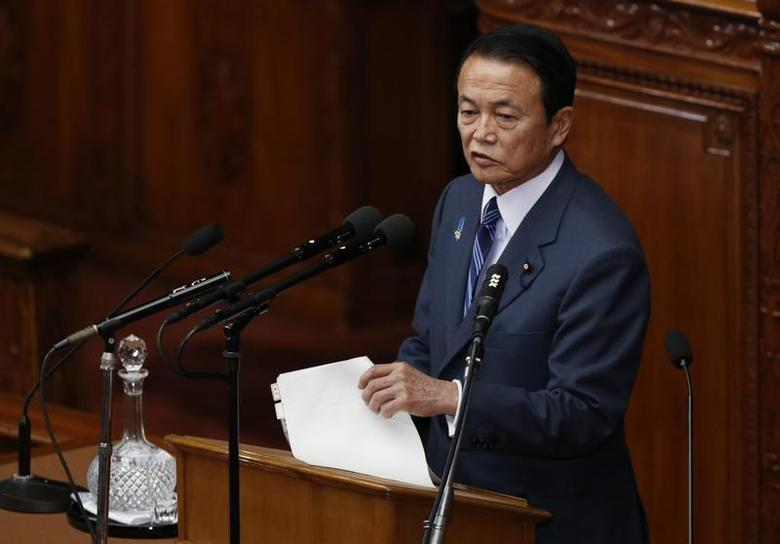 Japan's Finance Minister Taro Aso answers a question during a lower house plenary session at the parliament in Tokyo February 5, 2013. REUTERS/Issei Kato