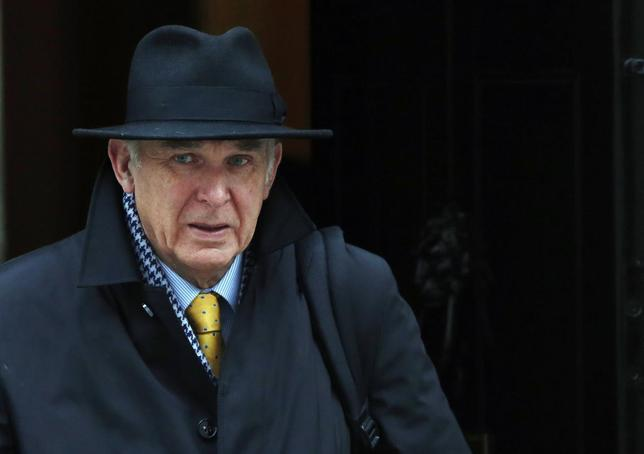 Britain's Business Secretary Vince Cable leaves Downing Street in London March 19, 2014. REUTERS/Luke MacGregor