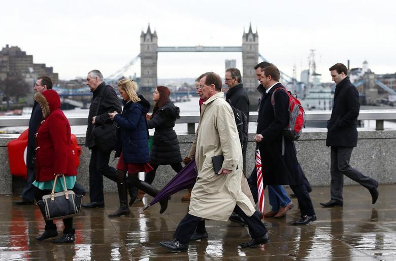 Tower Bridge is seen as workers cross London Bridge in London February 28, 2014. REUTERS/Eddie Keogh