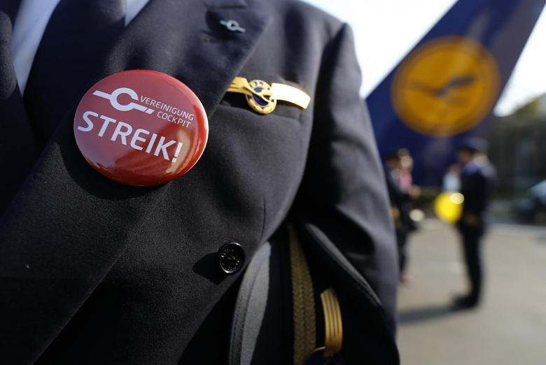 A pilot of German airline Lufthansa, sports a buttons reading ''strike'' on his uniform as he takes part in a demonstration at Fraport airport in Frankfurt April 2, 2014. REUTERS/Kai Pfaffenbach