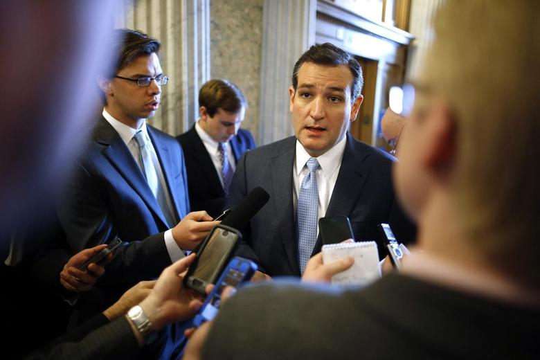 U.S. Senator Ted Cruz (R-TX) takes questions from reporters after the weekly Republican caucus luncheon at the U.S. Capitol in Washington March 11, 2014. REUTERS/Jonathan Ernst